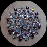 Broche ronde métal argenté à strass camaïeu de violet BRO027.