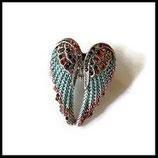 Bague  élastique argentée ailes d'ange bleu à strass multicolores  BAG069
