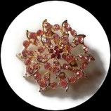 Broche ronde métal doré à strass roses BRO070.