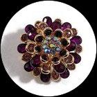 Grosse bague élastique 3D strass violets et roses métal doré BAG171