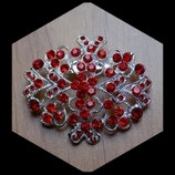 Broche ellipse argentée à strass rouges BRO025.