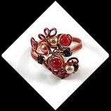 Bracelet fil aluminium doré et rouge, perles, modéle unique fait main