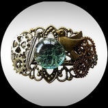 Bracelet style steampunk fait main engrenages, oiseau, plume
