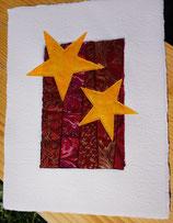 gelbe Sterne auf rotem Grund
