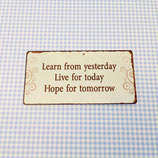 "Magnet ""learn, live, hope"""