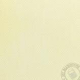 Scrapbookingpapier gelb mit kleinen Punkten