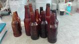Bouteille de bière factice en élastomère ( creuse ou pleine)