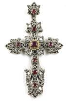 18 Karaat goud en zilveren kruishanger, bezet met roosdiamant en robijnen, ca.1890.