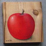 Apfel auf altem Fichtenbrett