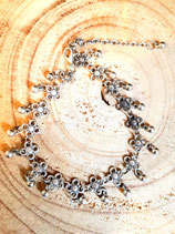 Bracelet de cheville argenté à breloques