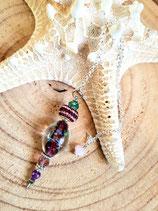 pendule violet perle incrustée