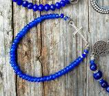 Bracelet élastique perles bleues et croix strassée
