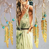 Créoles et plume dorées perles vertes