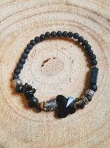 Bracelet en lave noire et papillon de verre facetté noir