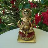 Ganesh doré sur Zafu rouge