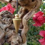 Pendule métal conique doré