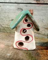 Häuschen mit Kupferschornstein