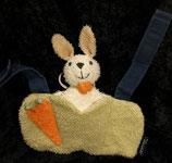 Sterntaler Maxi Cosi Spielzeug  Hase Frottee grün orange
