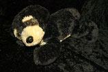 Kuschelwuschel / Karstadt Hund liegend schwarz beige