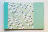 Album photos ou dessins grues sur fond bleu turquoise et or