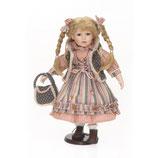Porzellan-Puppe mit Fellweste, 42 cm, Holzständer