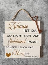 """Holzschild """"Zuhause ist..."""""""