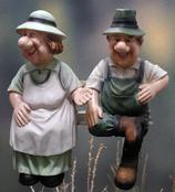 30220 Bauernpaar Figur auf Bank