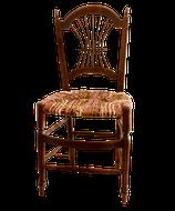 Une chaise ancienne au dossier en forme de lyre, paillée en torons de tissus de coton et waw africains