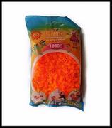 Perles à repasser HAMA Midi 5 mm couleur orange néon.
