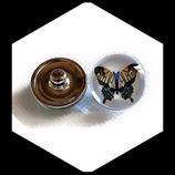 Bouton snap chunk en métal argenté papillon  fond blanc pour bijoux personnalisables.