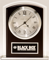 Beveled glass clock with wood accent, silver bezel and dial, three hand movement.