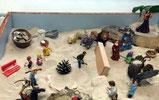 Menschheitsthemen im Sand