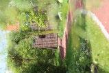 Der Garten unter anderem mit der Bobbycar-Rennstrecke.
