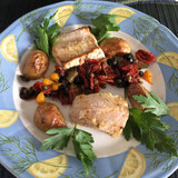 Steinbeißer mit Oliven-Kapern-Tomaten
