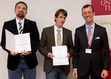 Henning Zelba & Dr. B. Weide get the prize for Paper of the Year from Dean Pof. Dr. Autenrieth (see Activities) on Oct 8, 2013..
