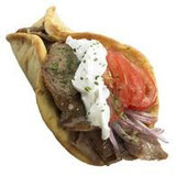 Gyro, dish of roasted meat,  usually served in a pita bread with tomato, onion, and tzatziki sauce.