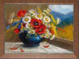 Feldblumen in blauer Vase