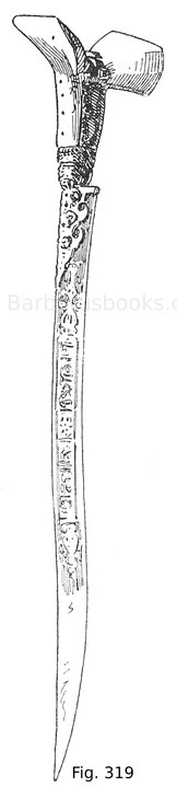 Fig. 319. Türkischer Handschar mit Griff aus Wallrosshorn, mit Silber montiert und mit geschnittenen Korallen besetzt. Aus dem Besitz des Fürsten Milosch Obrenowitsch. Modern.
