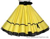 Gelber Petticoat mit schwarzem Gürte.