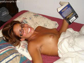Nude reading in bed