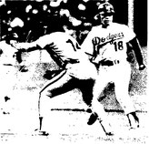 Pete Rose catches a pick-off attempt on Bill Russell.