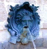 Mascaron de la fontaine St-Jacques