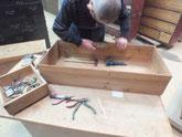 滋賀県より修理依頼の時代箪笥の引出取っ手を外し始めました。
