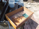 江南市より修理依頼を頂いた時代箪笥の引出を洗っています。