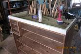 本体の塗膜を取り裏板を剥がし台輪を新たに作り裏板張り修理をしました。