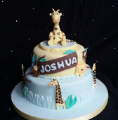 2 Tier boys jungle themed cake with giraffes, monkeys and lions