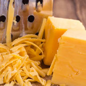 7 Side Effects of Eating Too Much Cheese, According to Experts