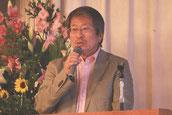 会社移転準備委員会の発表をする松井取締役