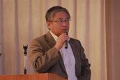 品質管理室、及びコンプライアンス委員会の発表をする明坂取締役
