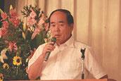 50周年記念事業実行委員会の発表をする西岡専務取締役